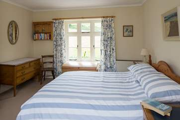 The double bedroom has countryside views on both sides.