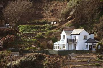 The Magazine is set within an acre of terraced gardens and has fabulous sea views.