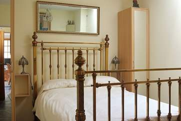 The ground floor bedroom has a lovely antique brass bedstead.