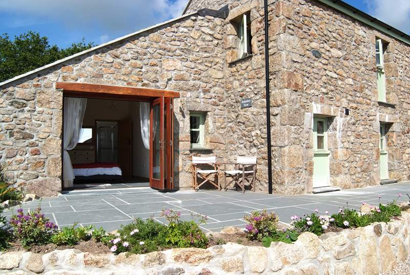 Folding glass doors open out from the double bedroom onto the front patio.