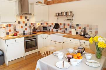The kitchen is beautifully fitted and has a Belfast sink and woodblock work surfaces.