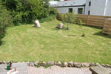 The lovely enclosed garden is perfect for relaxing and for the little ones to have fun in.