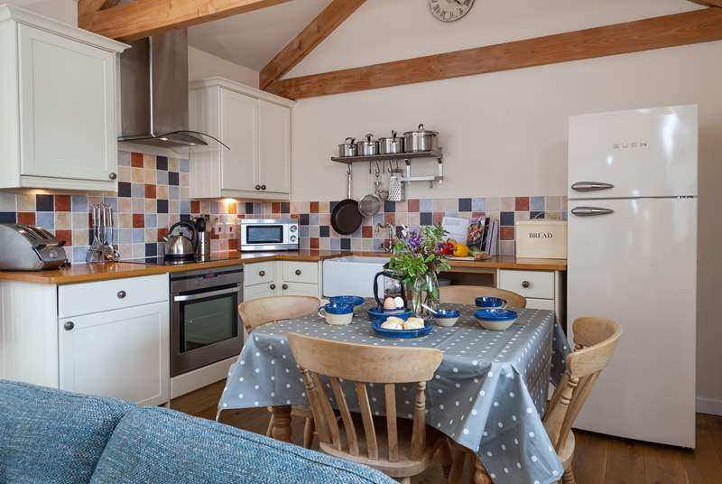 The kitchen is beautifully equipped and has a Belfast sink and woodblock work surfaces.