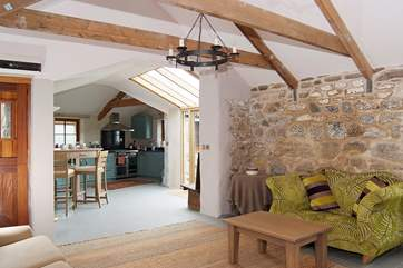 The cottage has cosy under-floor heating throughout, and the open beams, exposed stone and lime plaster walls give it lots of character.