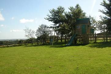 The large garden includes toddlers' swings and a raised Wendy House (please supervise younger children).