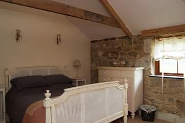 The double bedroom (Bedroom 1) overlooks the garden.