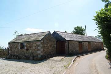 The front of the cottage, with the parking-area beside it.