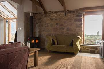 The cosy sitting area has a wood-burner.