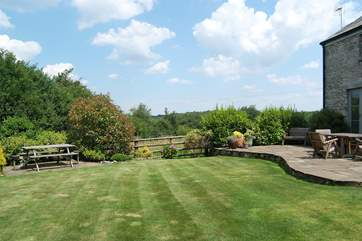 The lovely enclosed garden basks in sunshine.