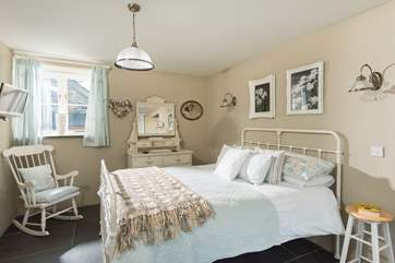 Soft relaxing colours in Bedroom 1.