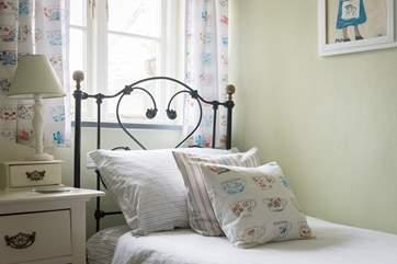 Bedroom 2 has beautiful antique bedsteads.