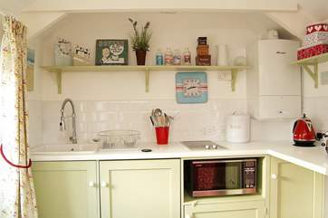 The kitchen-area is compact and attractive.