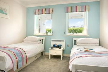 The twin bedroom has very bright and cheerful fabrics.