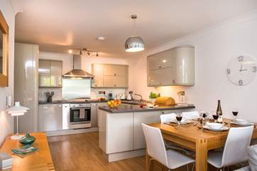 The kitchen is easily accessed from the dining-table.