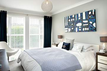 The master bedroom is bright and sunny and boasts an en suite shower room.