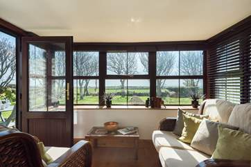 Enjoy the view from the conservatory in comfort at any time of year.