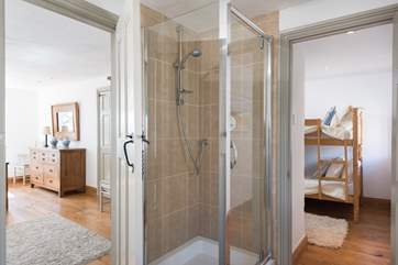 The large contemporary shower-room lies between the two bedrooms with 'Jack and Jill' doors.
