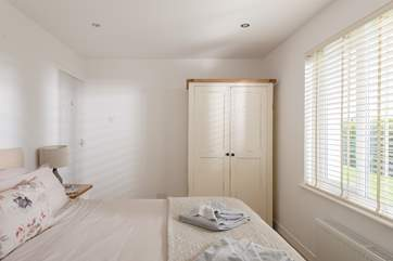 The bedrooms are dressed with lovely linens and all have plenty of storage.
