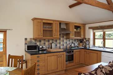 The well-equipped oak fitted kitchen.