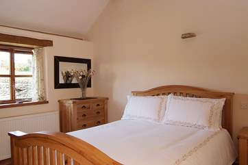 The double bedroom (Bedroom 1) has a beautiful oak king-size bed.