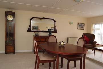 The spacious dining-room has a pleasant sitting-area.