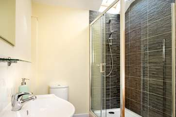 The bathroom also has a stylish shower