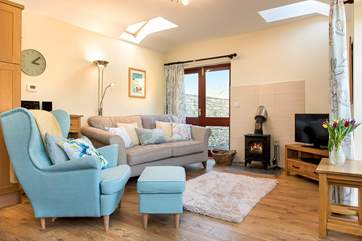 The woodburner makes this a great retreat all year round. Patio doors lead out to the garden