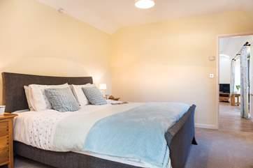 The bedroom has a super comfy 6' kingisze bed