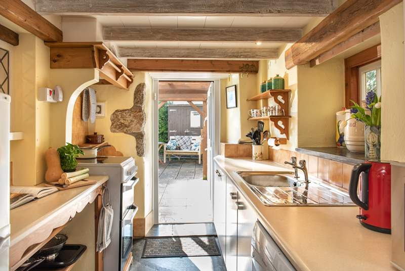 The kitchen opens to the sunny patio.