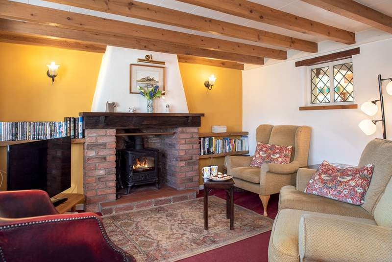 The cosy sitting room has a lovely wood burning stove.