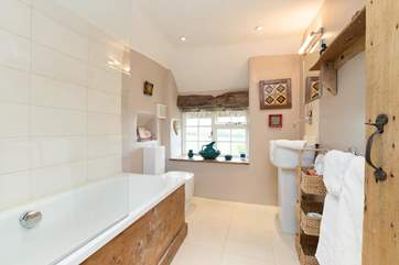 The bathroom looks out over the patio and side garden -  glimpses of the countryside whilst lazing in the bath !