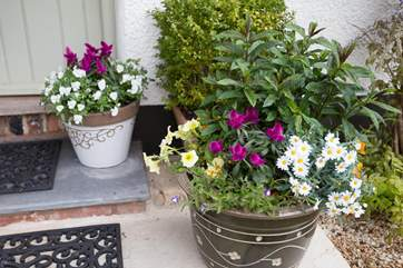 Your own doorstep garden adds to the welcome when you arrive.