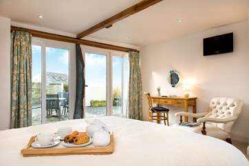 The dual-aspect bedroom boasts sea views.
