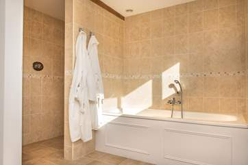 The bathroom is huge with a large walk-in shower. Bathrobes are also supplied.