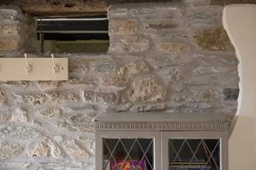A tiny window up in the hall wall gives more light to the kitchen/diner.