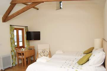 The annexe provides further accommodation for two, with its own wet-room and kitchenette (here it is made up as twin beds). This is a walk away from the cottage and not available at the lower price.