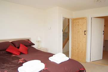 Bedroom 1 showing the door into the en suite bathroom.