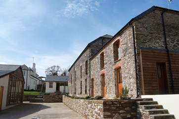 Aveton Cottage on the right, adjoining the Owners' transport museum (not open to the public), the annexe next door and the rear of the main farmhouse at the top. The pool-room is shown on the left.