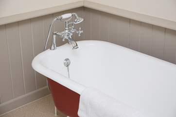 The bath in the ensuite for Bedroom 1.