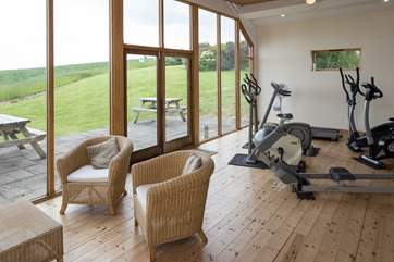 The small gym is equipped with a rowing machine, running machine, elliptical trainer and two exercise bikes.