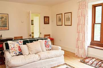 The sitting-room is light and comfortable.