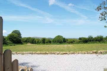 The lovely view across the meadow from the hot tub enclosure.