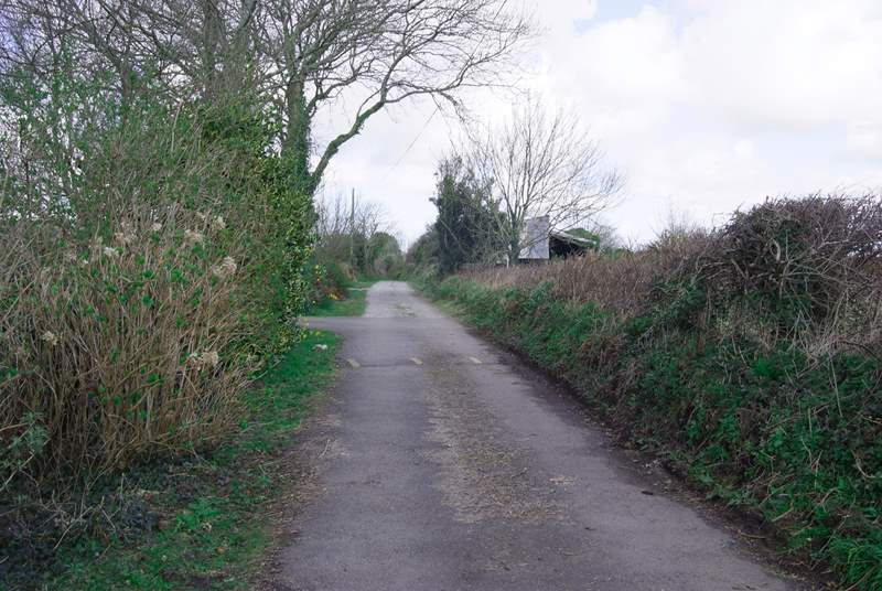 The lane is unmade but is very flat and well maintained with one small speedbump at this end.