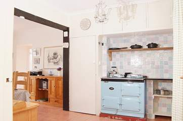 The oil-fired Aga makes the dining-room a cosy place to eat.