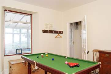 The playroom includes a small snooker table.