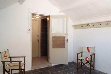 The large wet-room, in the courtyard just outside the back door, is ideal for rinsing off after days on the beach.
