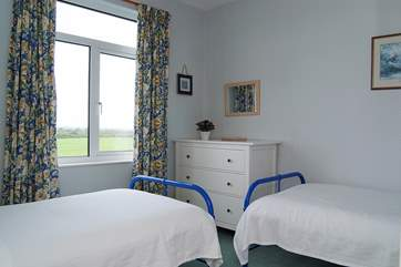 At the side of the house, this twin bedroom (Bedroom 5) overlooks the surrounding countryside.