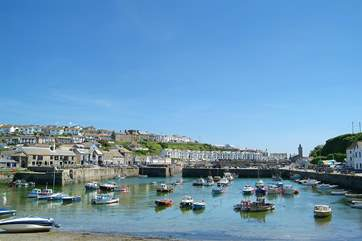 Porthleven's picturesque harbour is a short drive away.