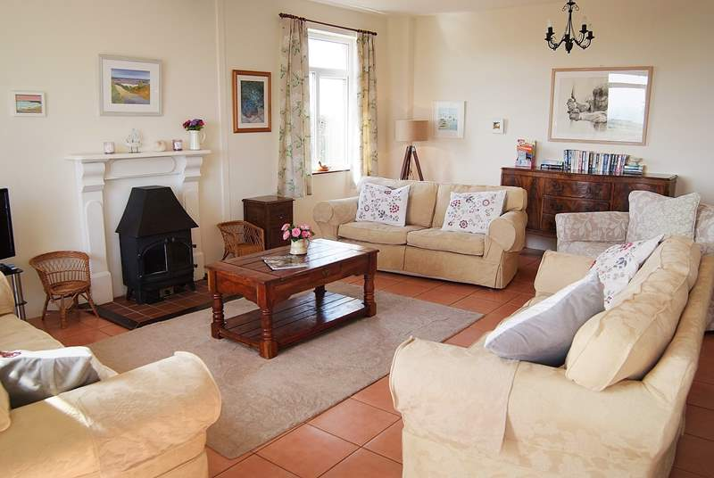 The spacious sitting-room is flooded with light and for those cooler evenings has a gas-fired stove.(now replaced with a wood burner on the opposite side of the room, photo to follow)