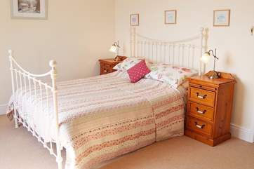 The master bedroom is very spacious, and is furnished with a king-size bed.